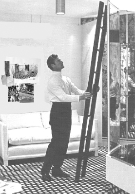 David Hicks in his London studio. Note the illustration on the wall behind him is the dining room for apartment 26.